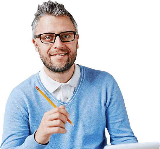 Man in blue sweater holding pencil - Wellness Psychotherapy Troy Michigan